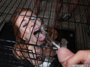Humiliated Fetish Skank In A Cage